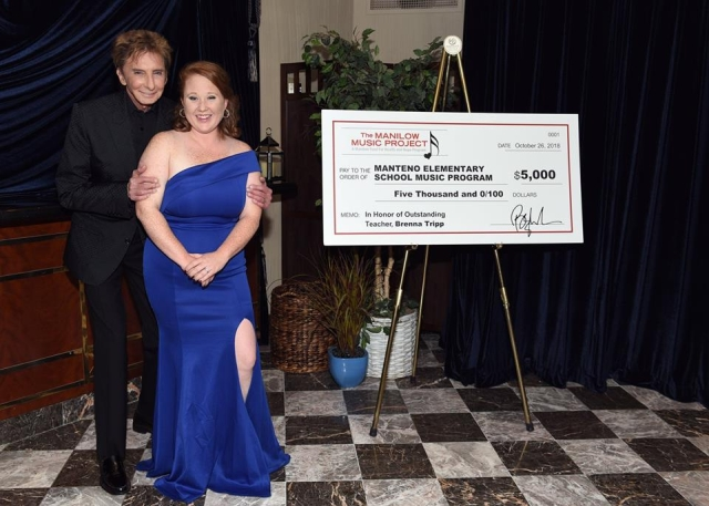 37d7587516 Brenna Tripp of Manteno Elementary School receives  5000 from Barry Manilow  and the Manilow Music Project for Manteno s music program!